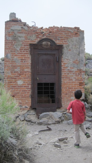 This is the Bodie Bank. Owen is looking at the only thing that survived the 1932 fire. What do you think it is? Answer: the vault.