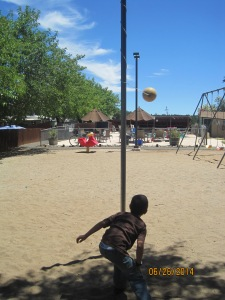 Owen playing tetherball. I remember playing this in elementary school. I never won because I was too short :(