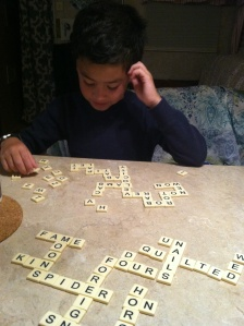 "Playing bananagrams to give me ""something to do""."