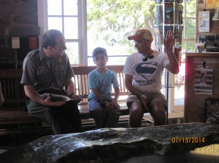 Owen sits down with a park ranger and they go over his activity book.