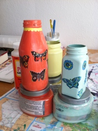 My first try painting jars and decoupaging using delicate napkin images.